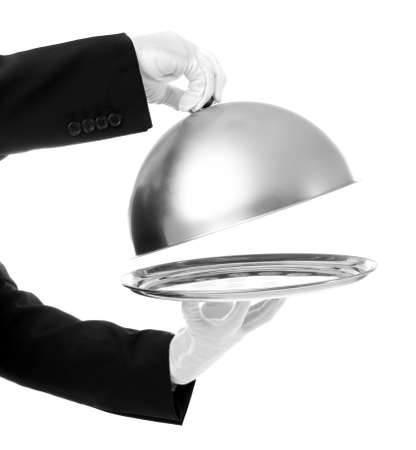 Waiter hands with cloche and tray on white background Stock Photo