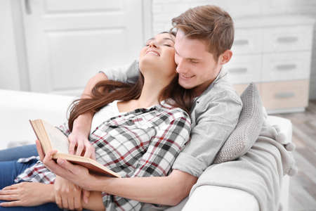 Lovely couple relaxing on couch Stock Photo
