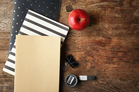 Colorful school stationery on wooden background, top view Imagens