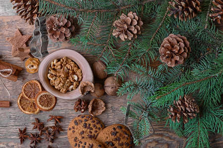 Christmas composition of natural decor on wooden background Фото со стока