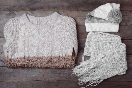 Set of winter clothes on wooden background Foto de archivo