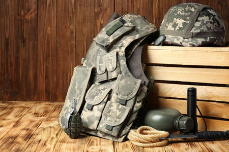 Set of military outfit on wooden background, close up Stock Photo