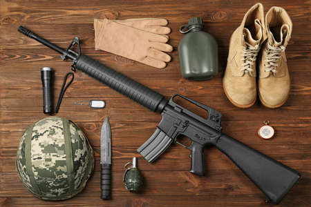 Set of military outfit on wooden background, top view Stock fotó