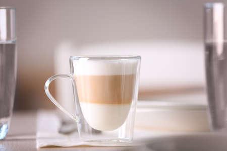 Tasty latte coffee on table