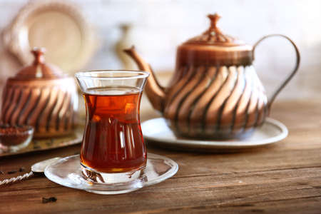 Turkish tea in traditional glass on wooden table closeup Stock Photo