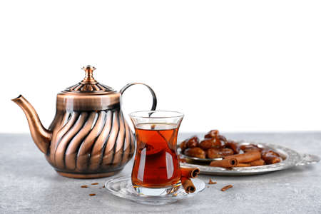 Turkish tea in traditional glass and metal teapot on white background Stock Photo