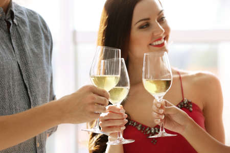 People toasting with glasses of white wine, closeup Stock Photo