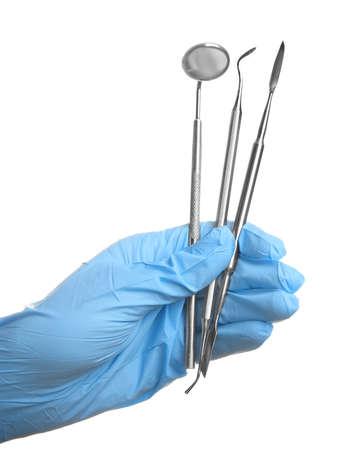 Hand holding dental equipment on white background
