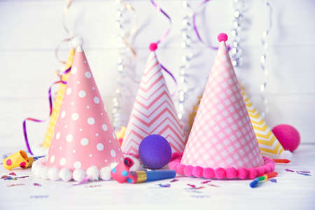 Birthday party caps on wooden background Stock Photo
