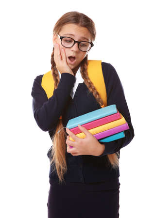 Teenage girl with backpack holding books on white background