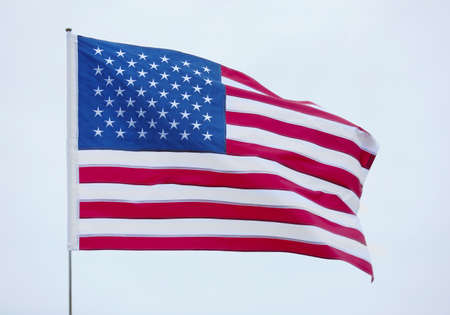 United States national flag on grey sky background