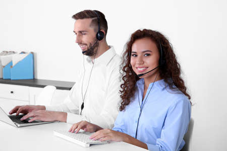 Two technical support dispatchers working in office