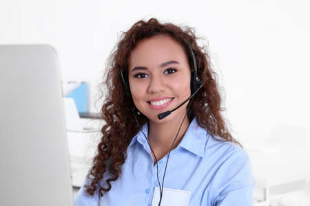 Young female technical support dispatcher working in office, closeup 写真素材