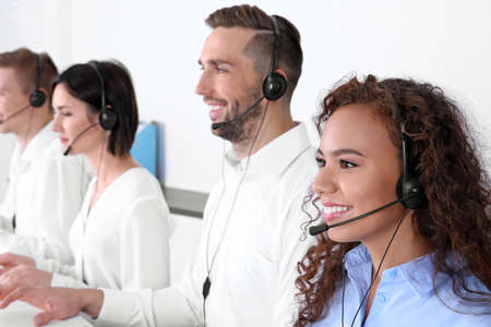 Team of technical support dispatchers working in office