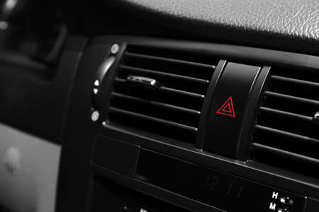 Emergency warning button on car console, closeup