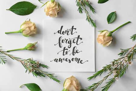 Quote Dont forget to be awesome written on paper with roses and leaves on white background. Top view