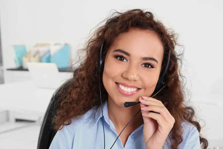 Young beautiful technical support dispatcher working in office, closeup