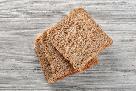 Sliced fresh bread on wooden background