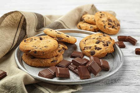 Tasty chocolate cookies on tray