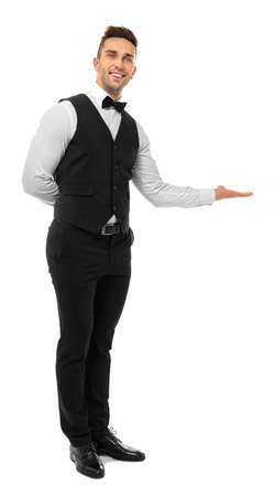 Handsome young waiter on white background