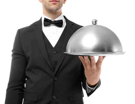 Waiter holding metal tray with cover on white background, close up view Stock Photo