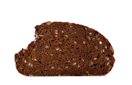 Slice of bread with seeds isolated on white