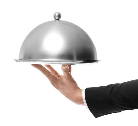 Hand van het metaaldienblad van de kelnersholding met dekking op witte achtergrond% 00 Stockfoto