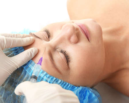 Hyaluronic acid injection for facial rejuvenation procedure Stock Photo