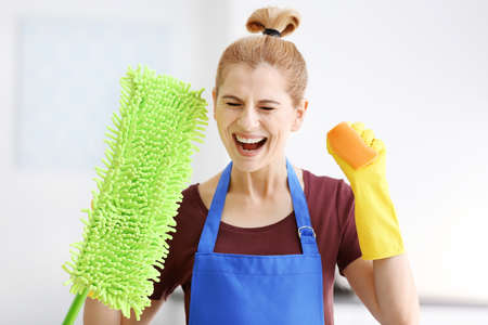 Funny adult woman with mop and sponge at home