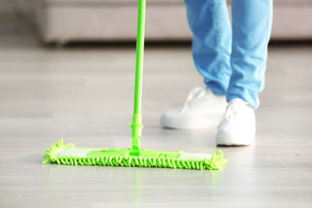Close up view of woman moping floor at home Stock Photo