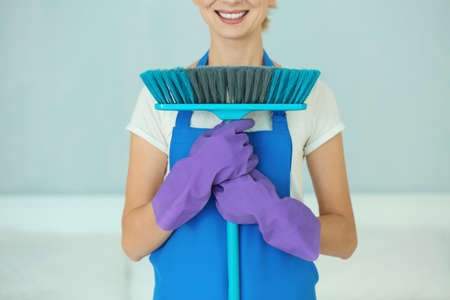 Funny adult woman with floor brush, close up view Stock Photo