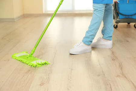 Close up view of woman moping floor at home Imagens