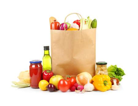 Fresh vegetables and foodstuff on white background Foto de archivo