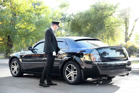 Chauffeur opening car door on the street