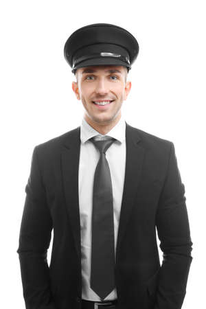Young chauffeur standing on white background Banco de Imagens