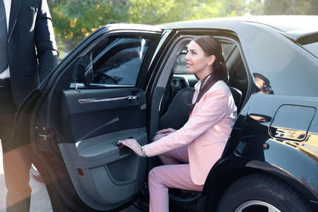 Businesswoman in luxury car