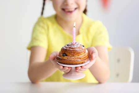 Cute little girl with birthday cake, close up view