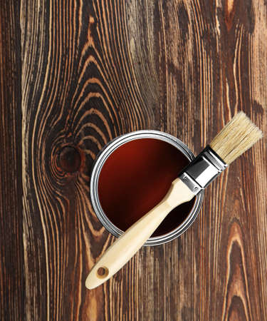 Paint and brush on wooden background, top view Stock Photo