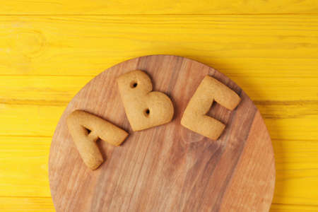 Cookie letters on wooden board, top view Stock Photo