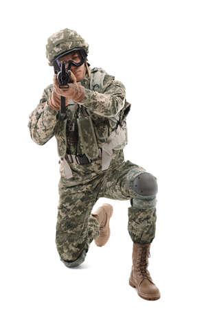Soldier in camouflage taking aim, isolated on white Stock Photo