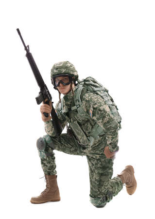 Soldier in camouflage with rifle, on white background Stock Photo