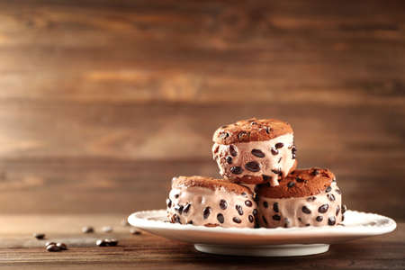 Delicious cookies with ice cream and chocolate chips on plate