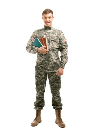 Soldier in camouflage holding books, on white background