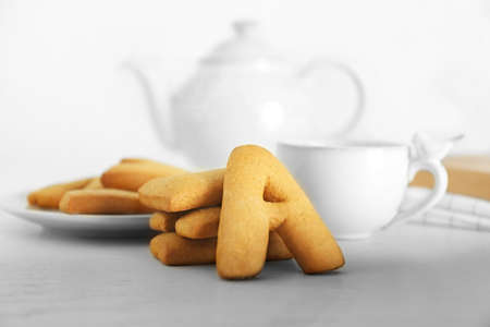 Cookie alphabet and tea on table