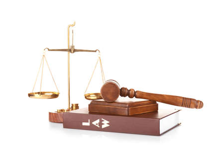 Judge gavel, scales and book on white background