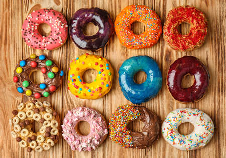 Glazed donuts on wooden background