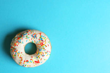 Glazed donut on color background