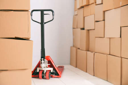 Manual pallet truck with carton boxes