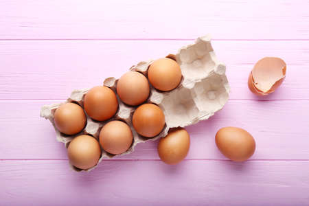 Eggs package on wooden background