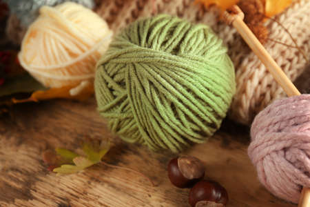 Knitting wool on wooden table